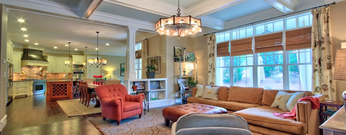 A handsome coffered ceiling adds style to the family room .